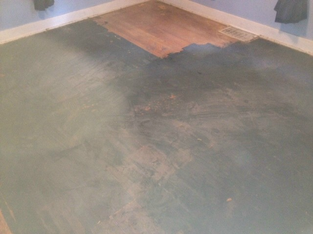 hardwood flooring with terrible black paint stains