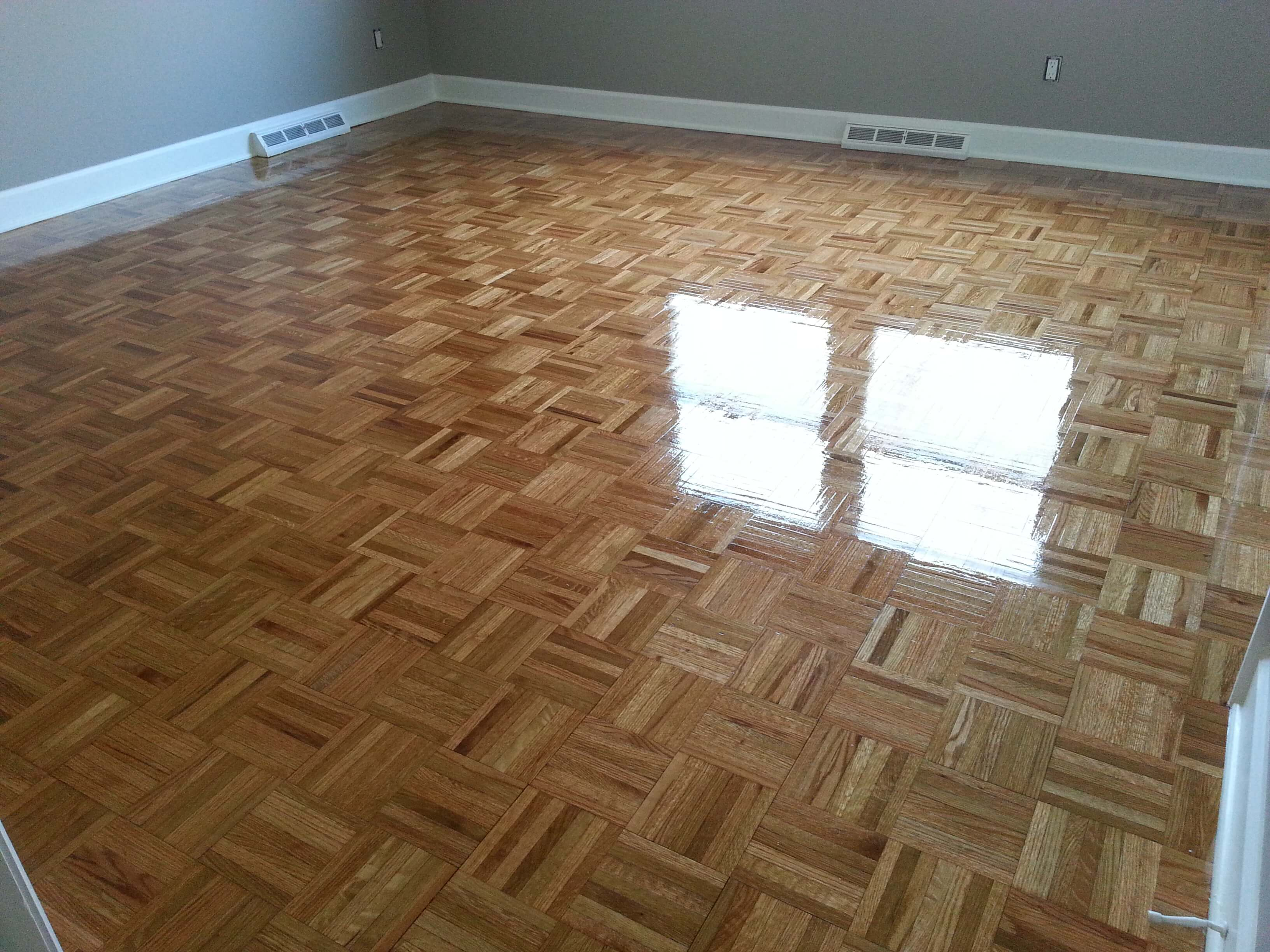 A refinished parquet wood floor