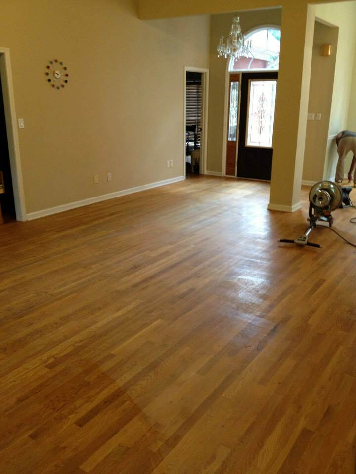light brown hardwood flooring with minor damages
