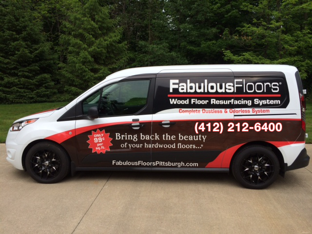 The Fabulous Floors Pittsburgh van parked outside of our office.